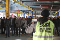 Railway workers gather during a meeting of the CGT and Sud Rail unions in Rennes, western France, Monday, Dec. 9, 2019. Unions launched nationwide strikes and protests over the government's plan to overhaul the retirement system. Paris commuters inched to work Monday through exceptional traffic jams, as strikes to preserve retirement rights halted trains and subways for a fifth straight day. (AP Photo/David Vincent)
