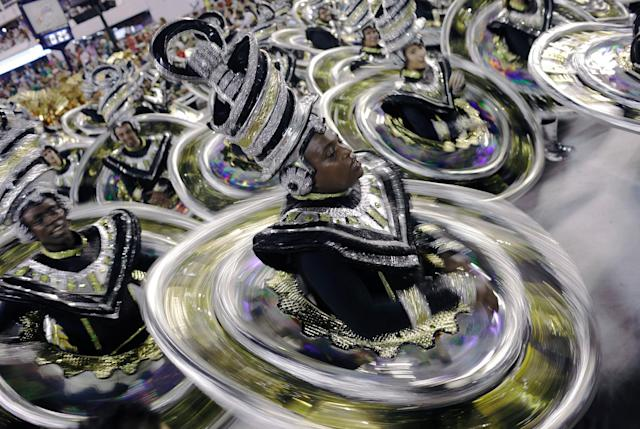 <p>Revellers from Vila Isabel Samba school perform during the first night of the Carnival parade at the Sambadrome in Rio de Janeiro, Brazil, Feb.11, 2018. (Photo: Ricardo Moraes/Reuters) </p>