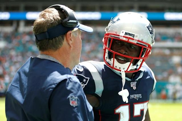 Receiver Antonio Brown celebrates with New England coach Bill Belichick after scoring a 20 yard touchdown in a 43-0 NFL win over the Miami Dolphins (AFP Photo/Michael Reaves)
