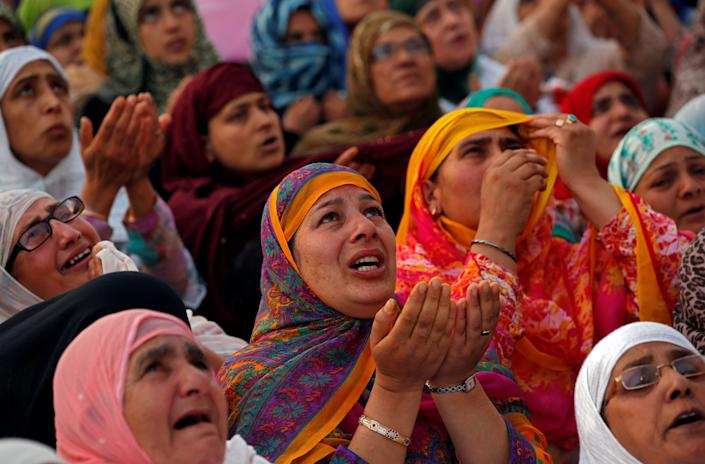 Kashmiri Muslim women cry and pray upon seeing a relic, believed to be a hair from the beard of Prophet Mohammad, displayed to devotees on the death anniversary of Hazrat Ali, son-in-law of Prophet Mohammad, at Hazratbal shrine during the holy month of Ramadan in Srinagar June 17, 2017. REUTERS/Danish Ismail