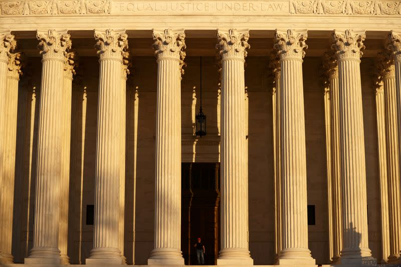 FILE PHOTO: A man walks at the U.S. Supreme Court building in Washington