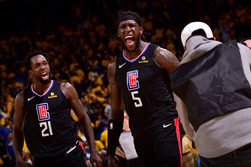 Clippers Patrick Beverley and Montrezl Harrell celebrate their 31-point comeback against the Warriors. (Getty Images)