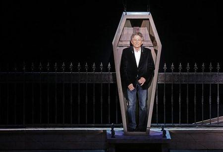 "Polish-French film director Polanski stands inside a coffin as he takes part in the presentation of the musical ""Le Bal des Vampires"" (Dance of the Vampires) at the Mogador theater in Paris"