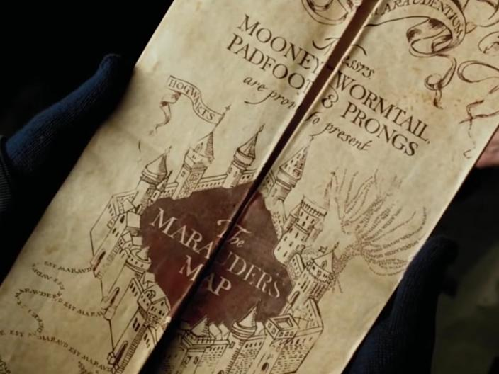 Fred and George give Harry the Marauder's map.