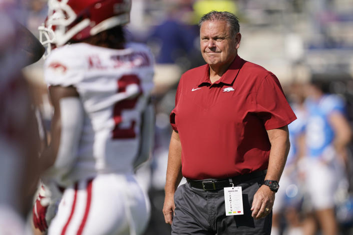 Arkansas head coach Sam Pittman watches his players as they warmup prior to their NCAA college football game against Mississippi, Saturday, Oct. 9, 2021, in Oxford, Miss. (AP Photo/Rogelio V. Solis)