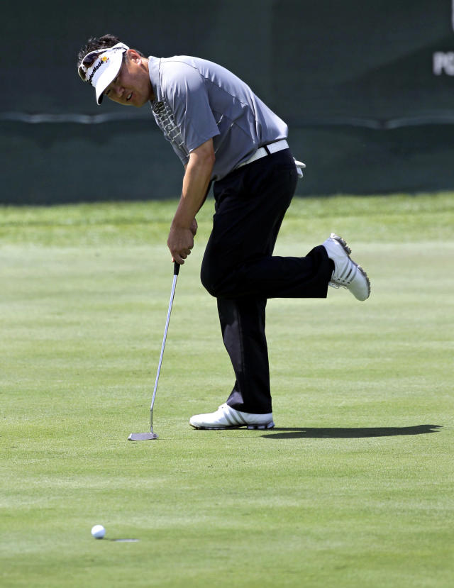 Charlie Wi kicks out his foot as a birdie putt on the 17th green stops short of the cup during the first round of the Arnold Palmer Invitational golf tournament at Bay Hill, Thursday, March 22, 2012, in Orlando, Fla. (AP Photo/John Raoux)