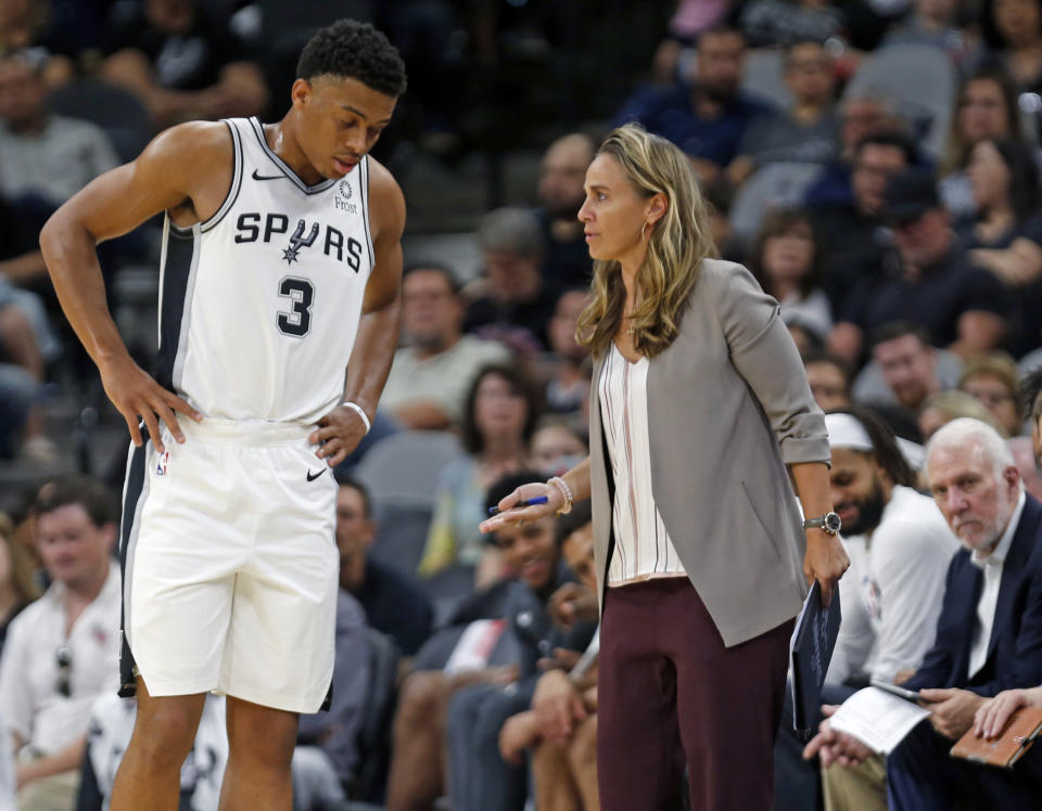 Carrie Taylor coached the Mount St. Joseph University men's soccer team over a decade ago, well before women like San Antonio Spurs assistant Becky Hammon (right) blazed their own trails. (Photo by Ronald Cortes/Getty Images)