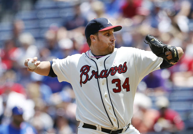Atlanta Braves starting pitcher Aaron Harang works in the first inning of a baseball game against the Chicago Cubs, Sunday, May 11, 2014, in Atlanta. (AP Photo/John Bazemore)