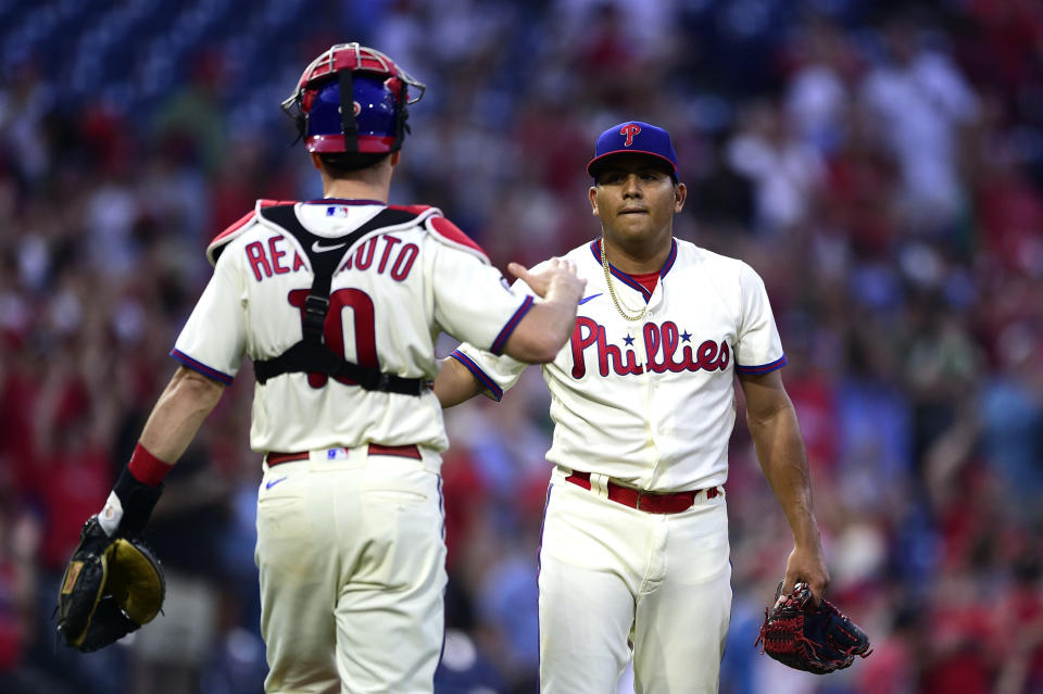 Philadelphia Phillies starting pitcher Ranger Suarez, right, is congratulated by J.T. Realmuto after their victory over the Pittsburgh Pirates, Saturday, Sept. 25, 2021, in Philadelphia. (AP Photo/Derik Hamilton)