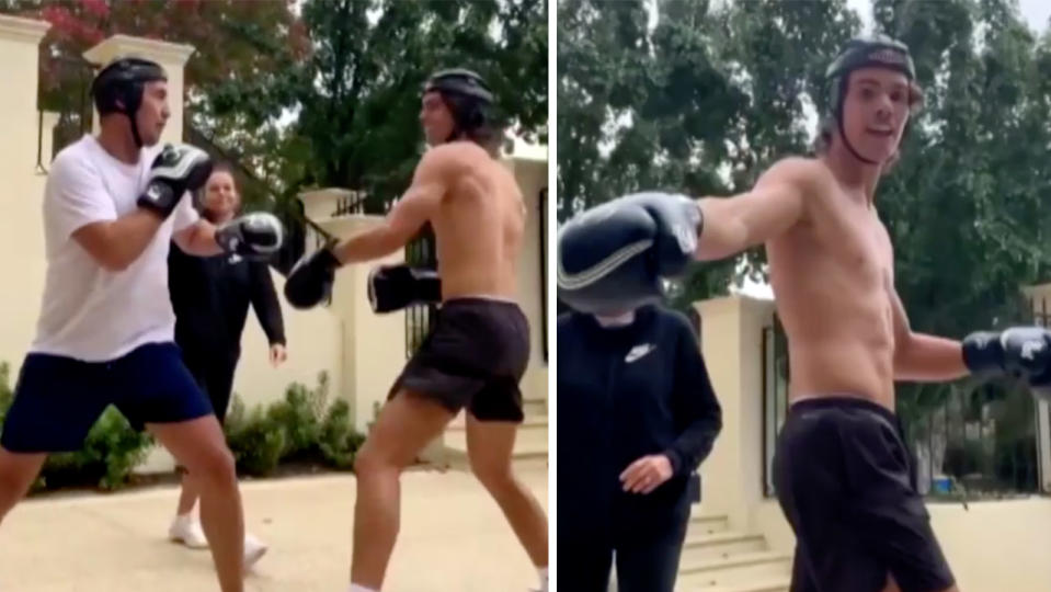 Blues legend Stehpen Silvagni sparred and throws punches with his son Ben (pictured right) in their font yard.