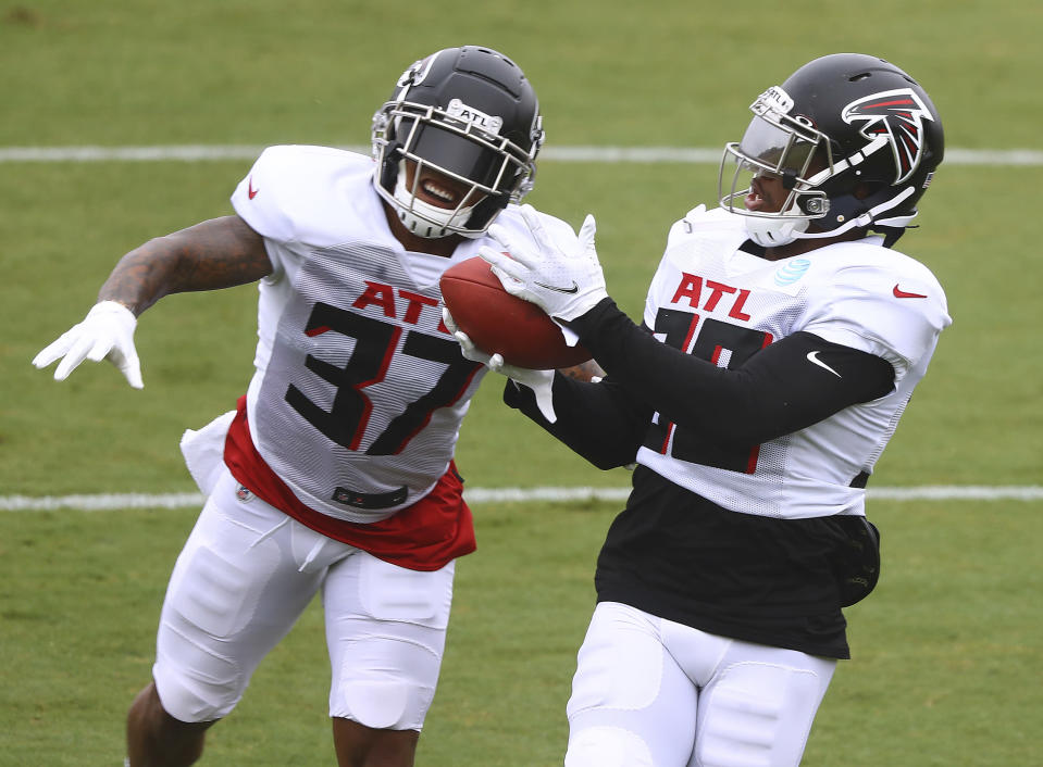 Atlanta Falcons safety Ricardo Allen, left, defends against cornerback Darqueze Dennard, right, during an NFL training camp football practice Saturday, Aug. 22, 2020, in Flowery Branch, Ga. (Curtis Compton/Atlanta Journal-Constitution via AP, Pool)