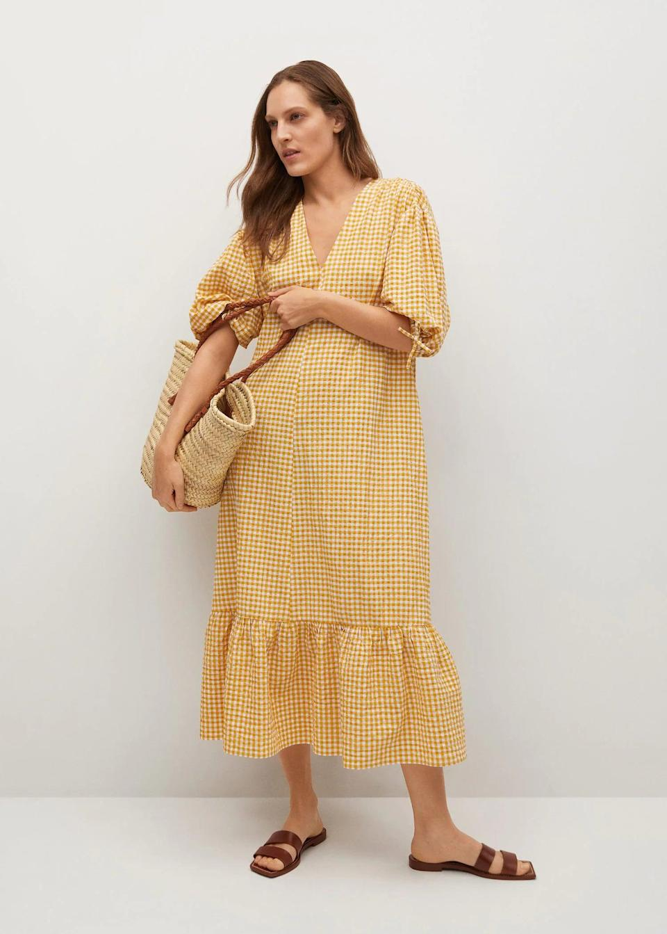 <p>This <span>Mango Gingham Check Cotton Dress</span> ($60, originally $100) will liven up your dress wardrobe in the best possible way. The flowy hem and puff sleeves add to the overall charm.</p>