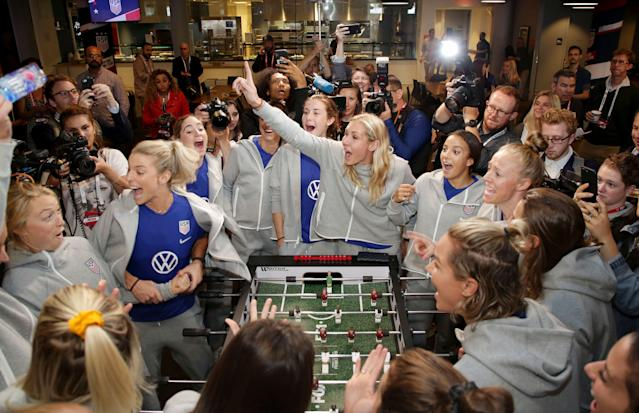 Member of the USWNT enjoyed playing foosball on a table featuring their likenesses. (Associated Press)