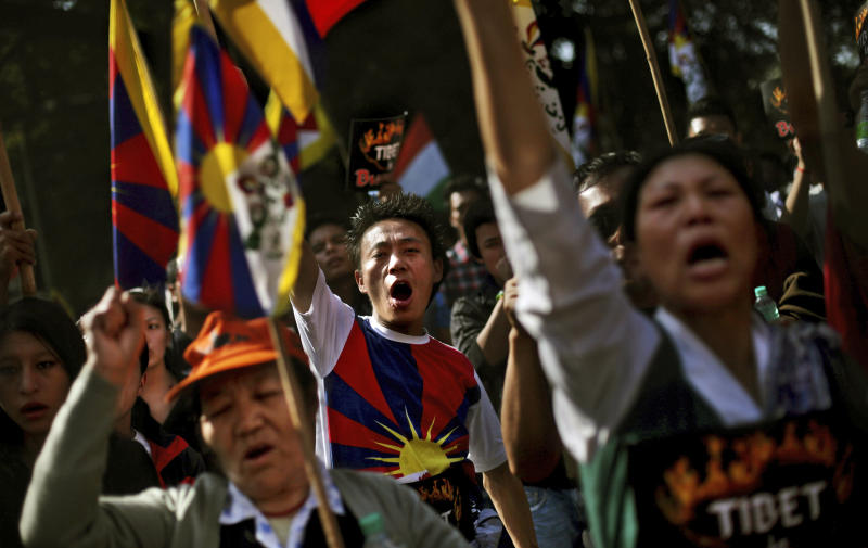 Exiled Tibetans shout slogans during a  protest rally to express solidarity with Tibetans who have self-immolated and to appeal for immediate international intervention in New Delhi, India, Wednesday, Nov. 28, 2012. At least 86 people have set themselves on fire since the immolations began in 2009.  (AP Photo/Altaf Qadri)