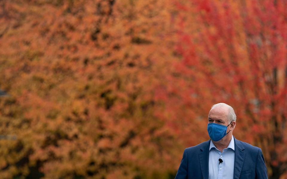 NDP Leader John Horgan arrives for a seniors roundtable in Coquitlam, B.C. on Oct. 20, 2020.  The British Columbia provincial election will be on Oct. 24.   (Photo: CP/Jonathan Hayward)