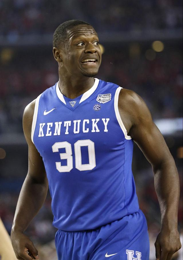 Kentucky forward Julius Randle reacts during the first half of an NCAA Final Four tournament college basketball semifinal game against Wisconsin Saturday, April 5, 2014, in Arlington, Texas. (AP Photo/David J. Phillip)