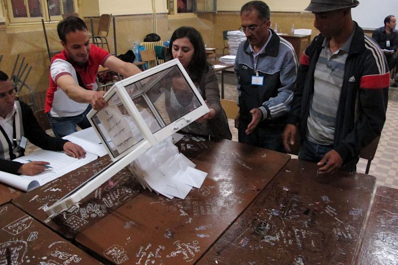 Workers at a polling station empty ballots to begin the counting process, in the Bab el-Oued neighborhood, Algiers, Thursday, May 10, 2012. As parliamentary elections unfolded across Algeria on Thursday, voting was light for much of day in the capital, despite these contests being billed the freest in 20 years. (AP Photo/Paul Schemm).