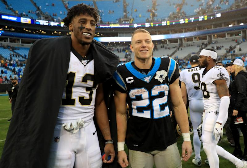 CHARLOTTE, NORTH CAROLINA - DECEMBER 29: Michael Thomas #13 of the New Orleans Saints poses for a picture with Christian McCaffrey #22 of the Carolina Panthers after their game at Bank of America Stadium on December 29, 2019 in Charlotte, North Carolina. (Photo by Streeter Lecka/Getty Images)