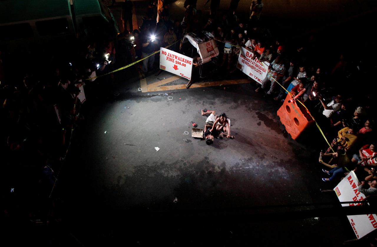 "ATTENTION EDITORS - VISUAL COVERAGE OF SCENES OF INJURY OR DEATHA woman weeps over the body of her husband, who was killed on a street by a vigilante group, according to police, in a spate of drug related killings in Pasay city, Metro Manila, Philippines July 23, 2016. A sign on a cardboard found near the body reads: ""Pusher Ako"", which translates to ""I am a drug pusher.""     REUTERS/Czar Dancel       TPX IMAGES OF THE DAY"