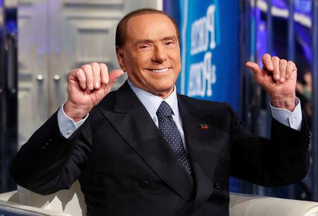 """Italy's former Prime Minister Silvio Berlusconi gestures during the taping of the television talk show """"Porta a Porta"""" (Door to Door) in Rome"""