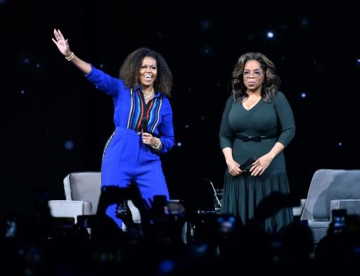 Media superstar Oprah Winfrey (R), seen at a February 8, 2020 event in New York with former First Lady Michelle Obama, said her friend CBS anchor Gayle King is 'feeling very much attacked' over an interview about Kobe Bryant