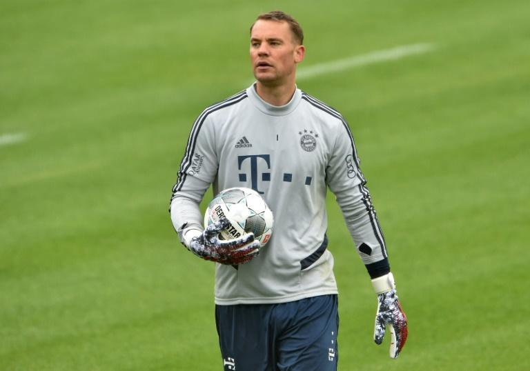 Goalkeeper Manuel Neuer will have a global audience when his side Bayern Munich face Union Berlin on Sunday (AFP Photo/Christof STACHE)
