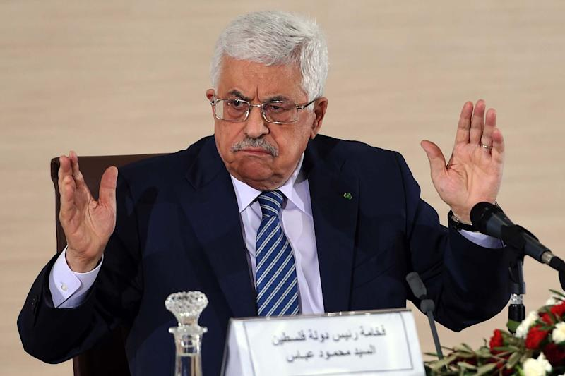 Palestinian President Mahmud Abbas speaks at a press conference at the Ministry of Foreign Affairs on December 23, 2014, in Algiers