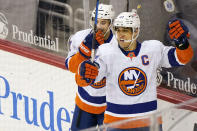 New York Islanders left wing Anders Lee, right, celebrates his game-winning goal during the third period of an NHL hockey game against the New Jersey Devils, Tuesday, March 2, 2021, in Newark, N.J. Islanders right wing Jordan Eberle (7) is at left. (AP Photo/Kathy Willens)