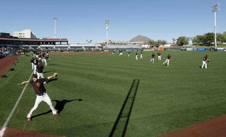 The San Francisco Giants payers warm up ahead of a training game against the Cleveland Indians, at Scottsdale Stadium in Arizona, on March 10, 2017