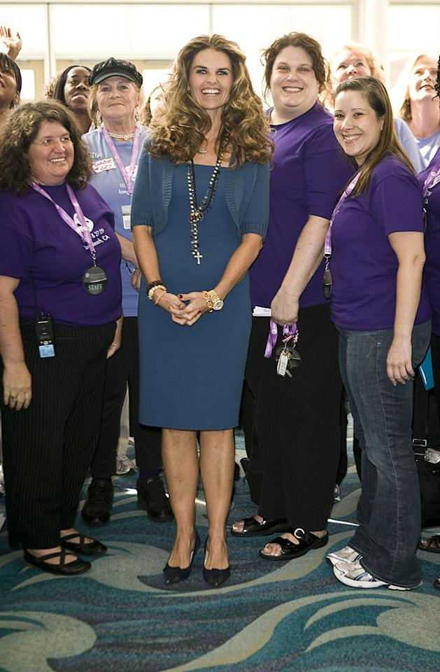 """The event's hostess, First Lady of California and illegal cell phone user Maria Shriver, poses for a picture with Jamba Juice representatives. Michael Bezjian/<a href=""""http://www.wireimage.com"""" target=""""new"""">WireImage.com</a> - October 26, 2009"""