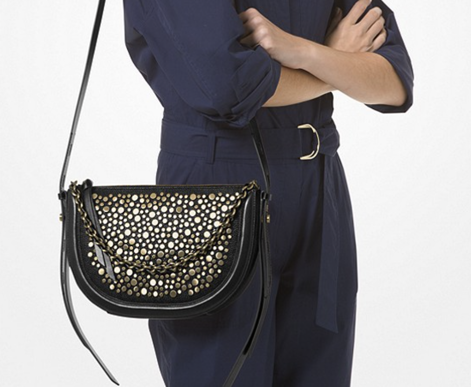 Jagger Small Studded Pebbled Leather Messenger Bag. (PHOTO: Michael Kors)