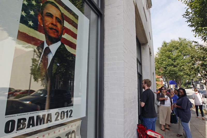 People wait outside a campaign field office in Raleigh, N.C., Thursday, Aug. 23, 2012 to receive credentials for President Barak Obama's acceptance speech during Charlotte's Democratic Convention. (AP Photo/Gerry Broome)