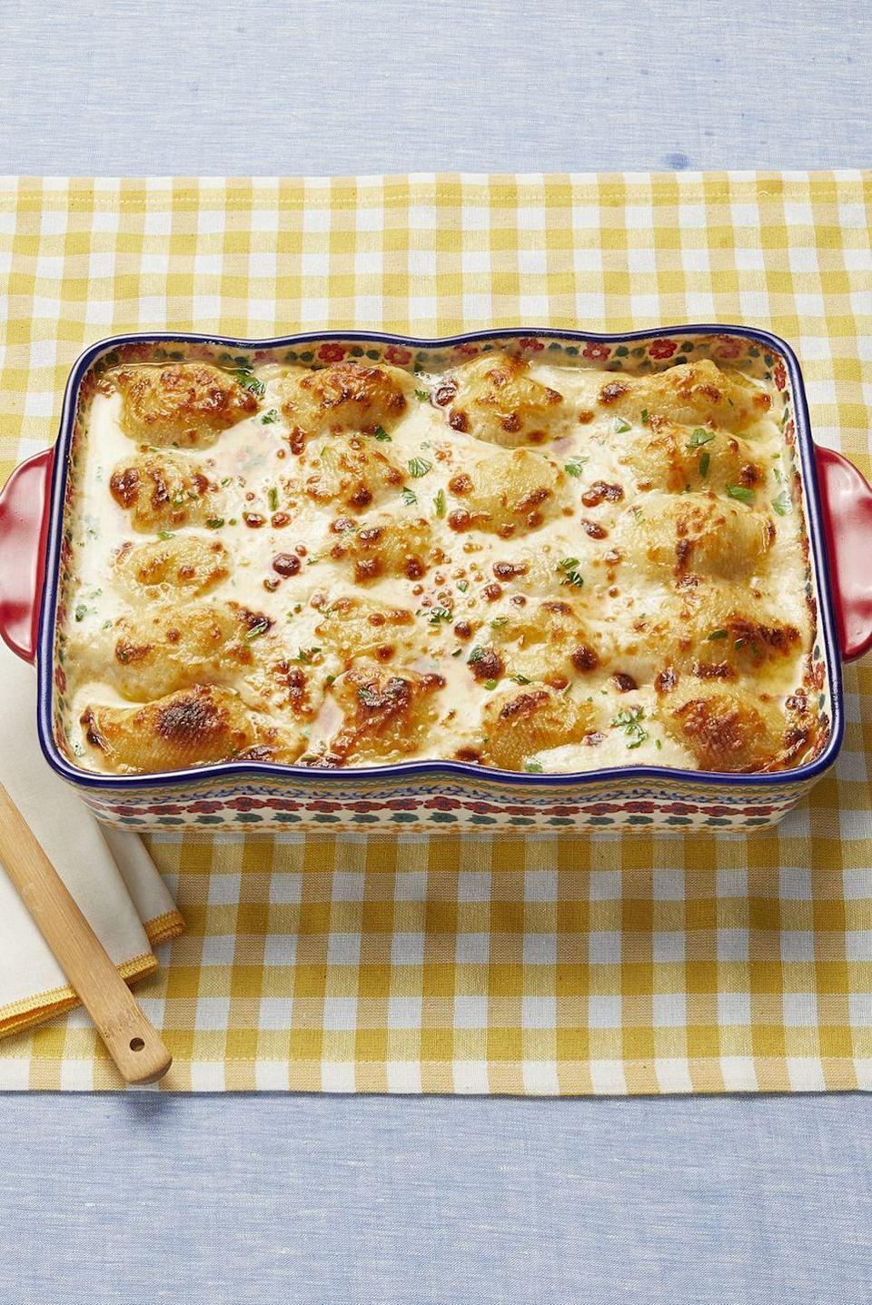 "<p>Make a hearty family meal on Christmas Eve with this classic pasta bake. Nothing says comfort food like chicken Alfredo and stuffed shells!</p><p><strong><a href=""https://www.thepioneerwoman.com/food-cooking/recipes/a97301/chicken-alfredo-stuffed-shells/"" rel=""nofollow noopener"" target=""_blank"" data-ylk=""slk:Get the recipe"" class=""link rapid-noclick-resp"">Get the recipe</a>.</strong></p><p><a class=""link rapid-noclick-resp"" href=""https://go.redirectingat.com?id=74968X1596630&url=https%3A%2F%2Fwww.walmart.com%2Fsearch%2F%3Fquery%3Dbaking%2Bdishes&sref=https%3A%2F%2Fwww.thepioneerwoman.com%2Ffood-cooking%2Fmeals-menus%2Fg35589850%2Fmothers-day-dinner-ideas%2F"" rel=""nofollow noopener"" target=""_blank"" data-ylk=""slk:SHOP BAKING DISHES"">SHOP BAKING DISHES</a></p>"