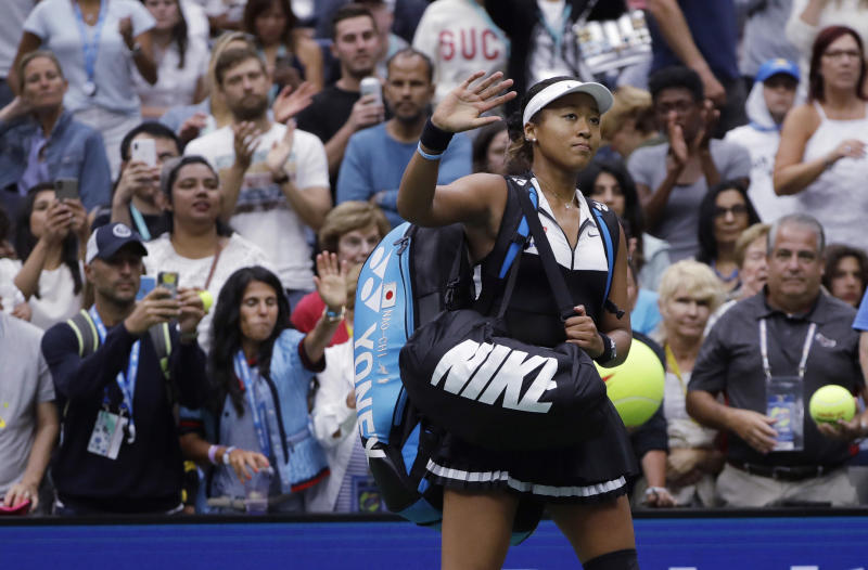 Naomi Osaka, of Japan, waves to the crowd after a 7-5, 6-4 loss to Belinda Bencic, of Switzerland, during the fourth round of the US Open tennis championships Monday, Sept. 2, 2019, in New York. (AP Photo/Frank Franklin II)