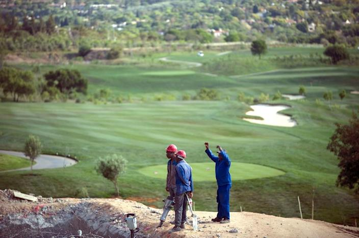 """Steyn City's developers say they have created jobs for 12,000 people Green, tidy, with safe public areas and winding bicycle paths -- Steyn City is a vast """"self-sufficient"""" development outside Johannesburg that highlights growing controversy over South Africa's divided urban society. (AFP Photo/Mujahid Safodien)"""