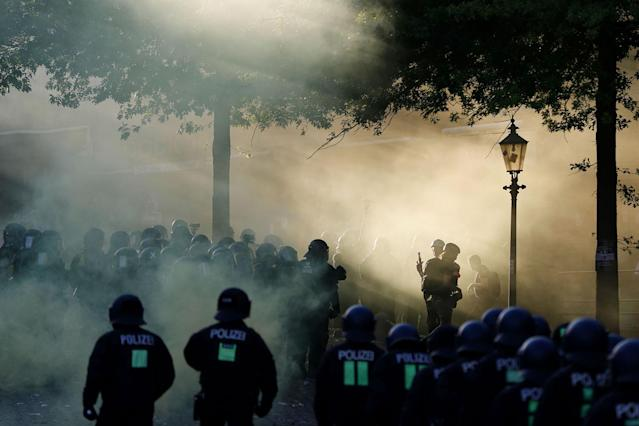 "<p>Riot police move in through the smoke during the ""Welcome to Hell"" rally against the G-20 summit in Hamburg, northern Germany on July 6, 2017. (Photo: Odd Andersen/AFP/Getty Images) </p>"