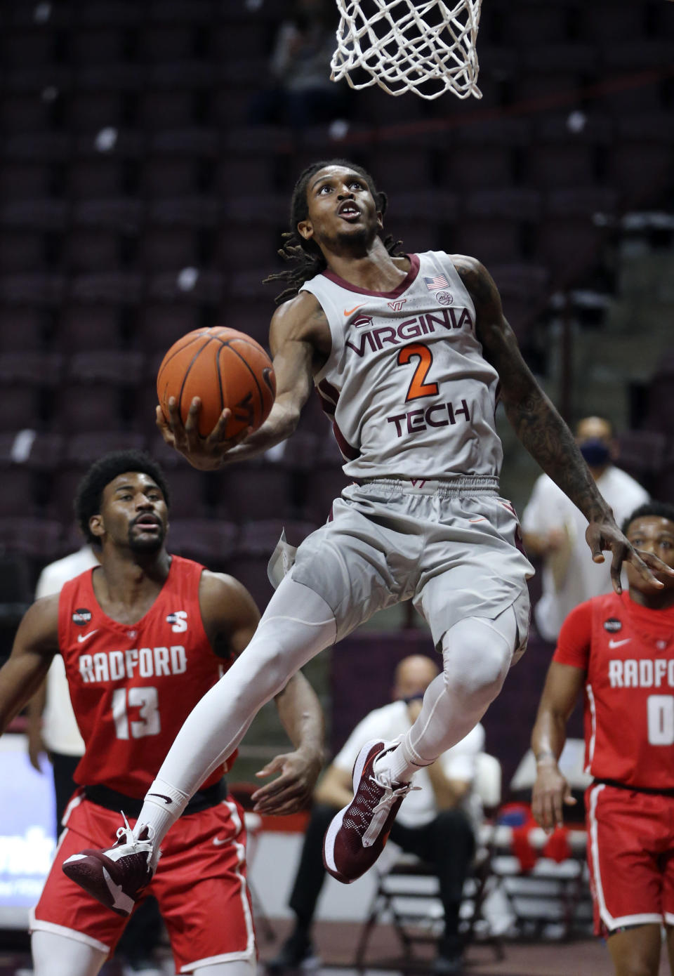 Virginia Tech's Cartier Diarra (2) scores past Radford defenders Shaquan Jules (13) and Fah'Mir Ali (0) during first half of an NCAA college basketball game, Wednesday Nov. 25, 2020, in Blacksburg Va. (Matt Gentry/The Roanoke Times via AP)