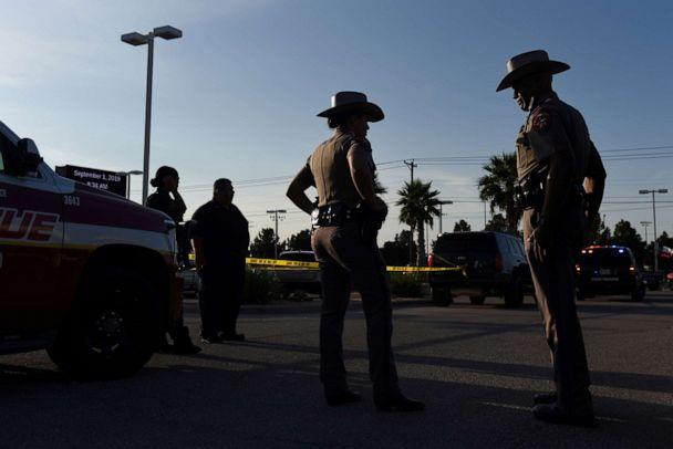 PHOTO: Texas state troopers and other emergency personnel monitor the scene at a local car dealership following a shooting in Odessa, Texas, Sept. 1, 2019. (Callaghan O'hare/Reuters)