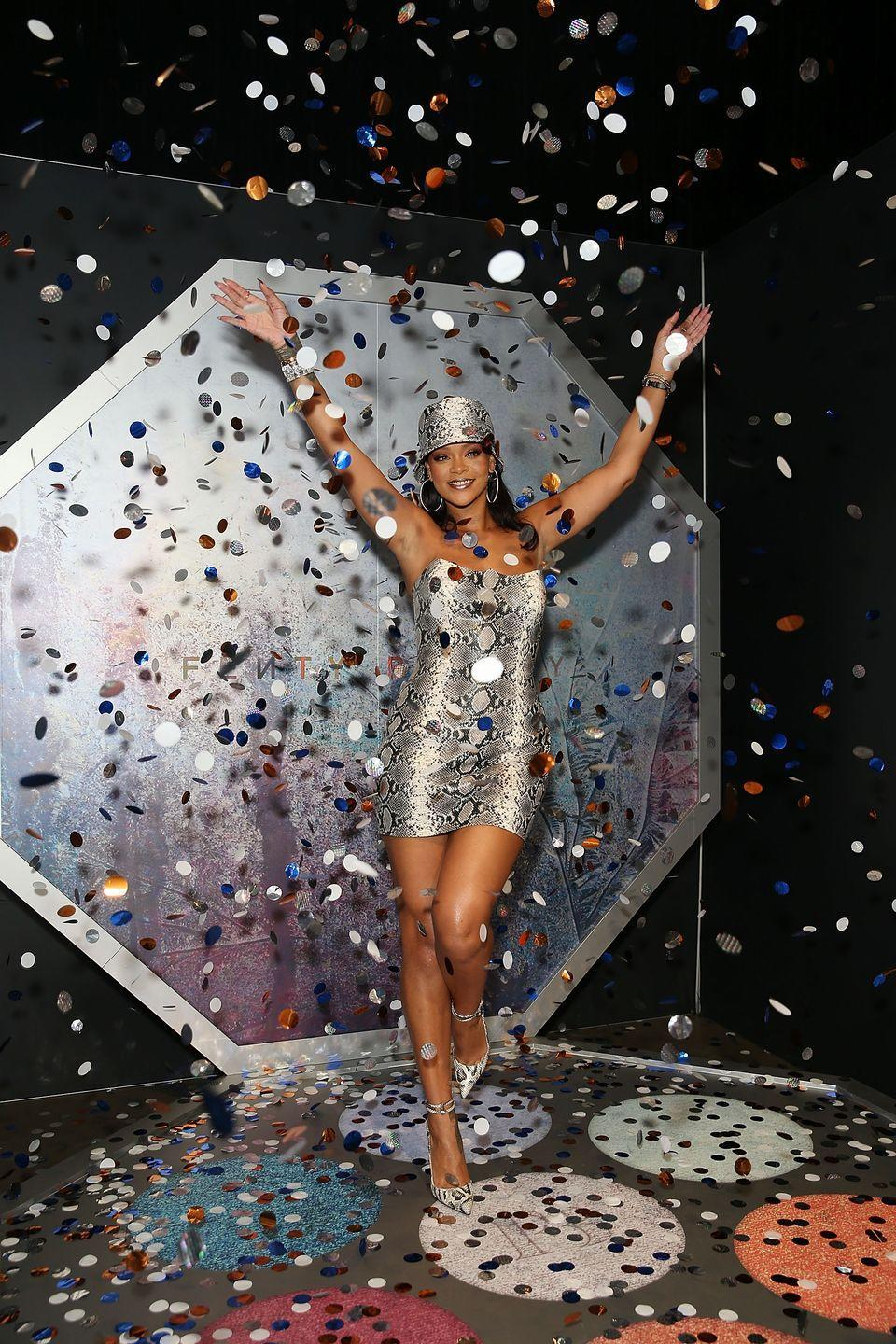 <p>In a custom made-to-order strapless snakeskin mini dress from Atelier Versace with matching bucket hat, heels from Louboutin, and jewels from Chopard for a Fenty Beauty press appearance in Sydney.<br></p>