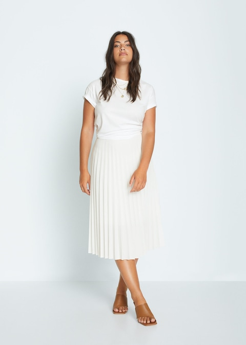"""Whoever said we have to stop wearing white after Labor Day never saw this all-white look. <br> <br> <strong>Violeta By Mango</strong> Pleated Midi Skirt, $, available at <a href=""""https://go.skimresources.com/?id=30283X879131&url=https%3A%2F%2Fshop.mango.com%2Fus%2Fplus-size%2Fskirts-midi%2Fpleated-midi-skirt_77050554.html"""" rel=""""nofollow noopener"""" target=""""_blank"""" data-ylk=""""slk:Mango"""" class=""""link rapid-noclick-resp"""">Mango</a>"""