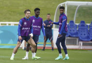 England's Jack Grealish, Bukayo Saka and Marcus Rashford, from left, during a training session at St George's Park, Burton upon Trent, England, Saturday July 10, 2021, ahead of their Euro 2020 soccer championship final match against Italy at Wembley Stadium on Sunday. (AP Photo/Dave Thompson)