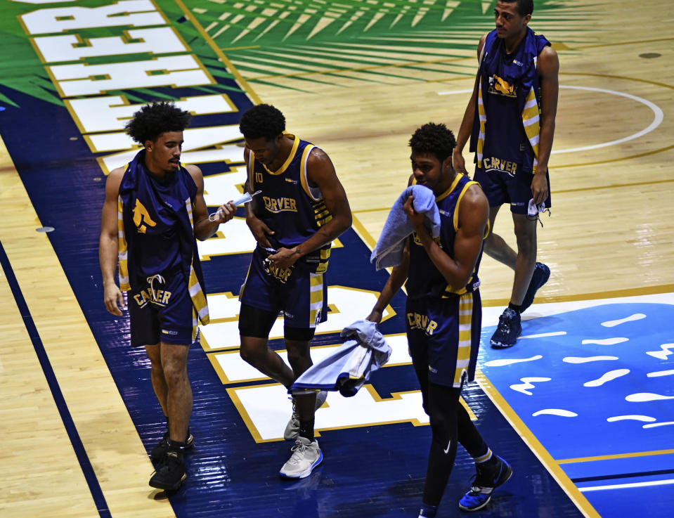 Carver College players walk back to the locker room during halftime against Florida International Monday, Dec. 21, 2020, in Miami. (AP Photo/Gaston De Cardenas)