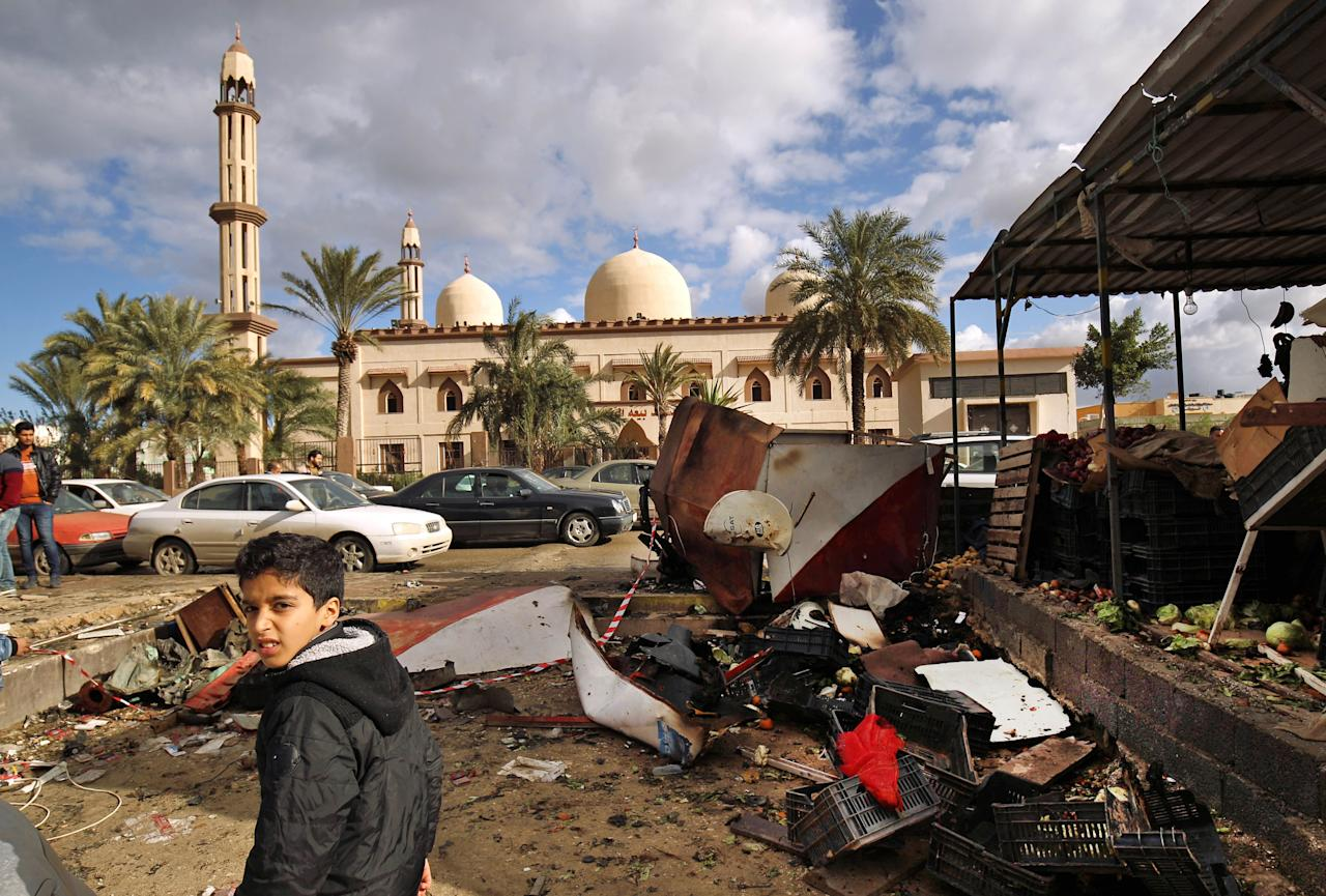 <p>Libyans check the aftermath of an explosion in the eastern city of Benghazi on Jan. 24, 2018.<br /> (Photo: Abdullah Doma/AFP/Getty Images) </p>