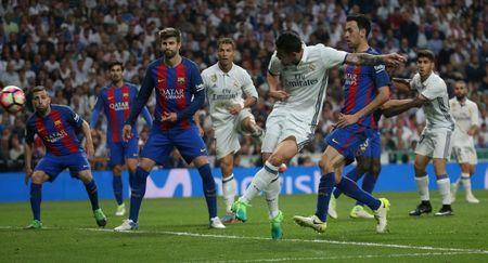 Football Soccer - Real Madrid v FC Barcelona - Spanish Liga Santander - Santiago Bernabeu, Madrid, Spain - 23/4/17 Real Madrid's James Rodriguez scores their second goal Reuters / Sergio Perez Livepic