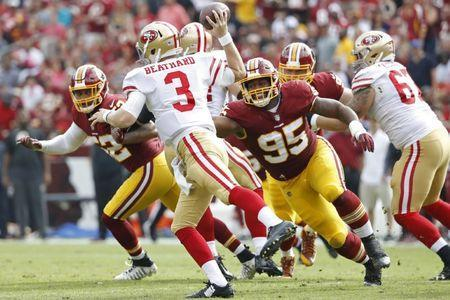 Oct 15, 2017; Landover, MD, USA; San Francisco 49ers quarterback C.J. Beathard (3) passes the ball as Washington Redskins defensive end Jonathan Allen (95) chases in the second quarter at FedEx Field. Mandatory Credit: Geoff Burke-USA TODAY Sports
