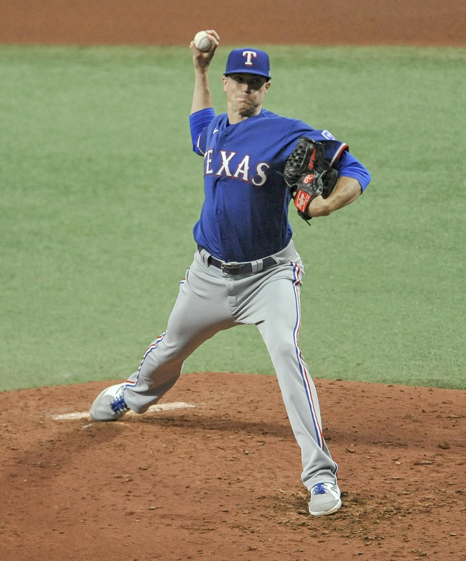 Texas Rangers starter Kyle Gibson pitches against the Tampa Bay Rays during the fourth inning of a baseball game Tuesday, April 13, 2021, in St. Petersburg, Fla. (AP Photo/Steve Nesius)