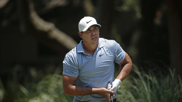 Though his knee has still been bothering him, Brooks Koepka is trying to make a push for the FedExCup Playoffs before seeking treatment. (AP/Gerry Broome)