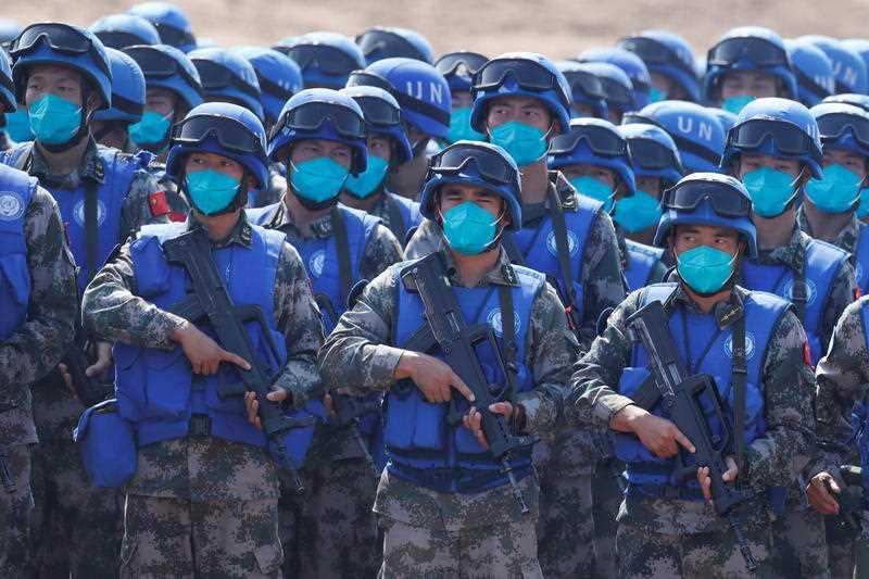 Soldiers of Chinese People's Liberation Army (PLA) take part in a joint multinational UN peacekeeping military exercise with troops from Pakistan, Mongolia and Thailand, on the outskirts of Zhumadian, Henan province, China.