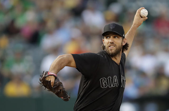 San Francisco Giants pitcher Madison Bumgarner works against the Oakland Athletics during the first inning of a baseball game Saturday, Aug. 24, 2019, in Oakland, Calif. (AP Photo/Ben Margot)