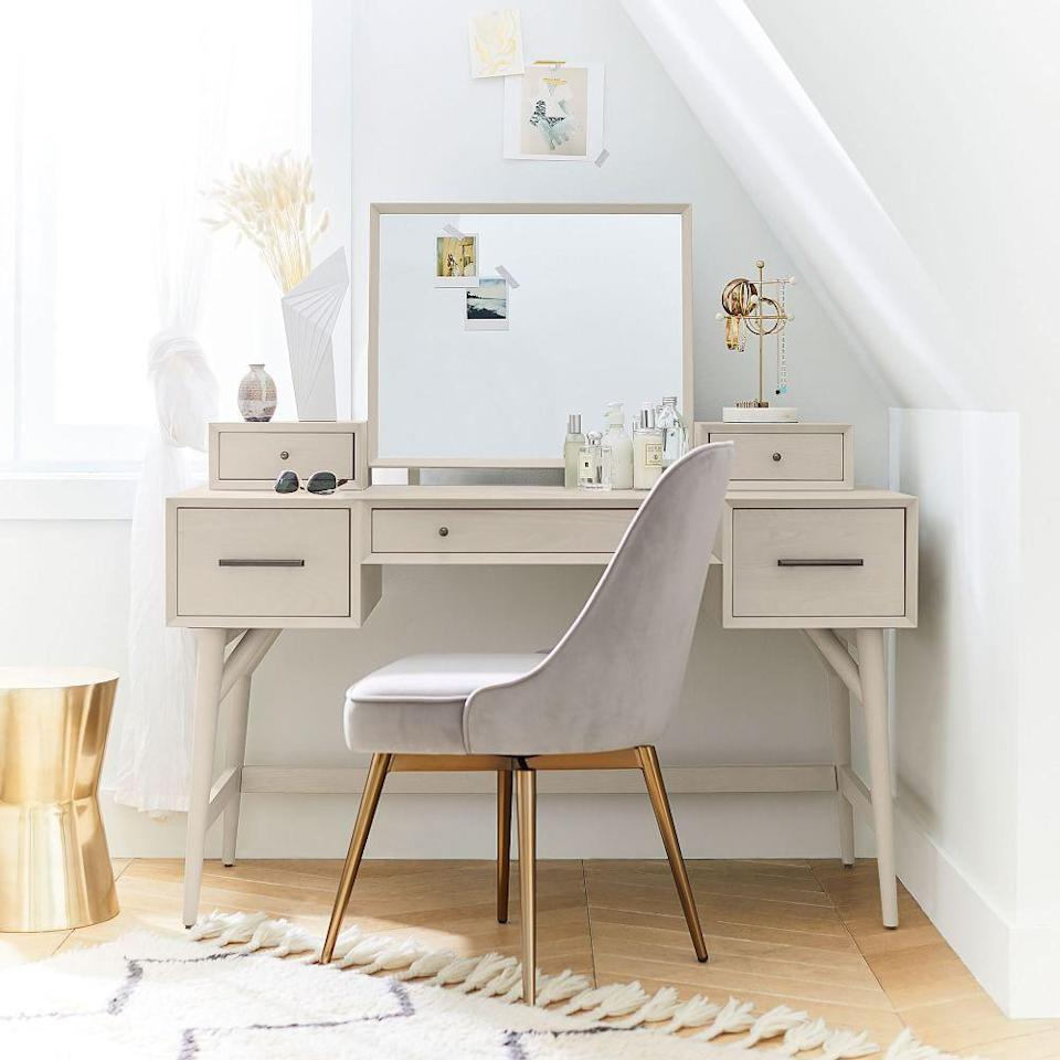 """<p><strong>West Elm</strong></p><p>westelm.com</p><p><strong>$998.00</strong></p><p><a href=""""https://go.redirectingat.com?id=74968X1596630&url=https%3A%2F%2Fwww.westelm.com%2Fproducts%2Fmid-century-vanity-hutch-acorn-d7203&sref=https%3A%2F%2Fwww.cosmopolitan.com%2Flifestyle%2Fg36689175%2Fbest-makeup-vanity-with-storage%2F"""" rel=""""nofollow noopener"""" target=""""_blank"""" data-ylk=""""slk:Shop Now"""" class=""""link rapid-noclick-resp"""">Shop Now</a></p><p>Found: a S-T-U-N-N-I-N-G vanity with five (!!!) drawers and a sophisticated design. God, I love her.</p>"""